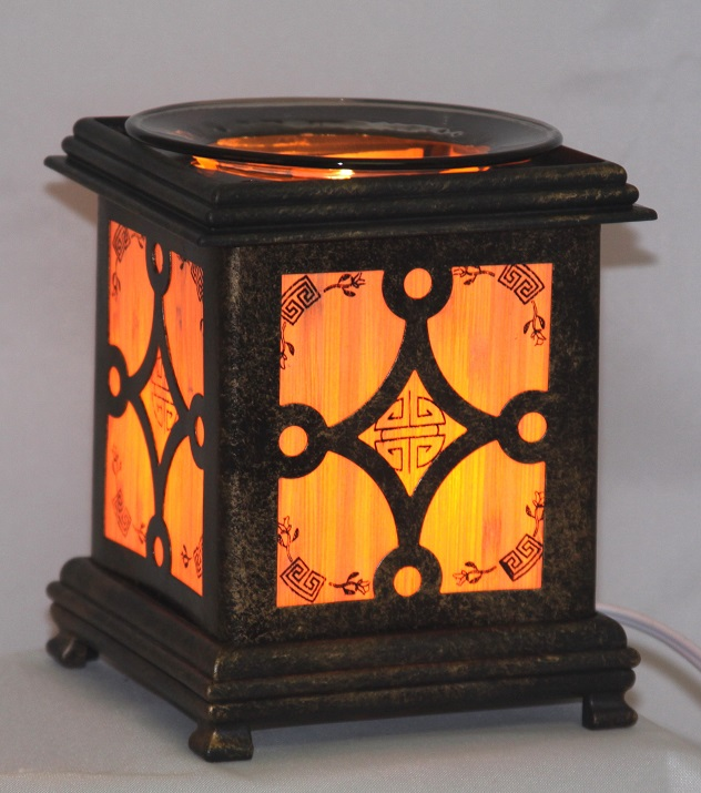 EW-717 - WHOLESALE ONLY ELECTRIC OIL BURNER. ALUMINUM METAL. DIMMER SWITCH IS ON THE CORD TO ADJUST THE BRIGHTNESS OF THE LAMP. CAN BE USED AS A NIGHT LIGHT OR OIL LAMP.