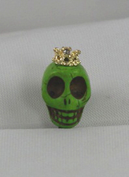 EARCAP15  GREEN SKULL CELL PHONE CHARMS - PLUGS INTO THE CELL PHONE WHERE THE EAR PHONE GOES. PREVENT DUST AND WATER GOES IN, AND MOST IMPORTANTLY, IT'S AN EXTRA BLING!