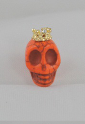 EARCAP16  ORANGE SKULL CELL PHONE CHARMS - PLUGS INTO THE CELL PHONE WHERE THE EAR PHONE GOES. PREVENT DUST AND WATER GOES IN, AND MOST IMPORTANTLY, IT'S AN EXTRA BLING!
