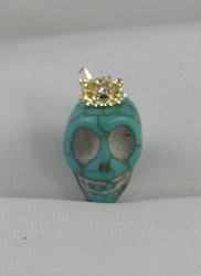 EARCAP17  TURQUOISE SKULL CELL PHONE CHARMS - PLUGS INTO THE CELL PHONE WHERE THE EAR PHONE GOES. PREVENT DUST AND WATER GOES IN, AND MOST IMPORTANTLY, IT'S AN EXTRA BLING!