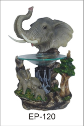 EP-120 ELEPHANTS POLY RESIN OIL BURNER - Poly Resin Electric Oil Burner/fragrance lamp. Price is each pc, its packed 4 pcs to a case.