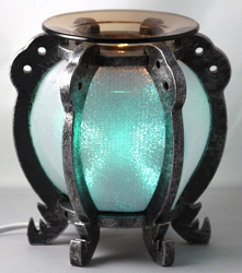 EW-728 - WHOLESALE ONLY ELECTRIC OIL BURNER. ALUMINUM METAL. DIMMER SWITCH IS ON THE CORD TO ADJUST THE BRIGHTNESS OF THE LAMP. CAN BE USED AS A NIGHT LIGHT OR OIL LAMP.