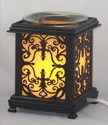 EW-747 - WHOLESALE ONLY ELECTRIC OIL BURNER. ALUMINUM METAL. DIMMER SWITCH IS ON THE CORD TO ADJUST THE BRIGHTNESS OF THE LAMP. CAN BE USED AS A NIGHT LIGHT OR OIL LAMP.